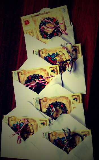 array of CHristmas cards and envelopes with hair ties included