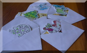 child-made decorations in Christmas card envelopes