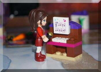 Lego girl at piano