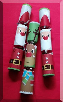 three Christmas bonbons with Santa and Rudolph faces