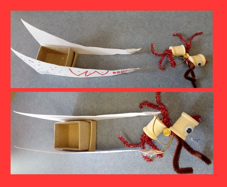 CLose up images of Santa's sleigh made from paper and a cardboard box
