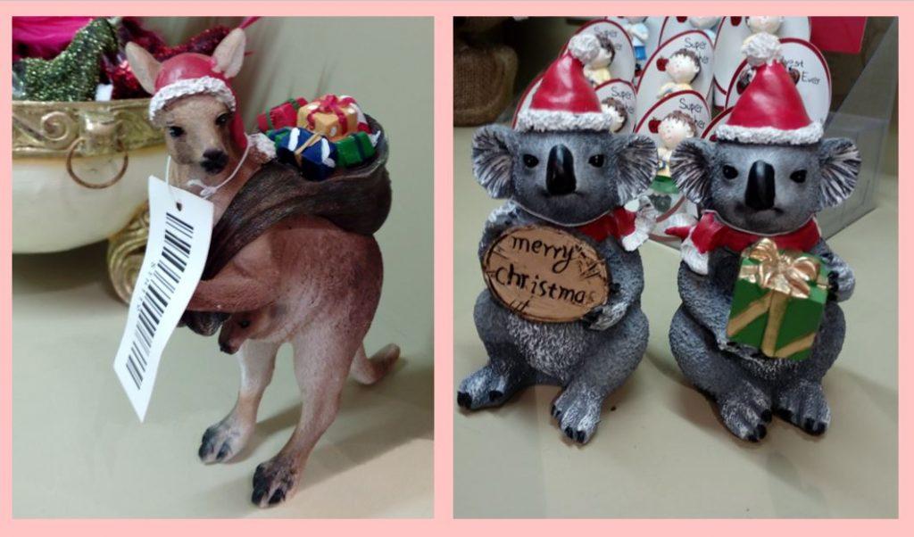 A kangaroo and two koalas holding Santa sacks of toys