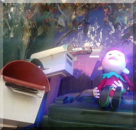 Myer elf beside some letter boxes
