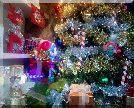 Reindeer, Angel, Elf and Mouse enjoy their Christmas tree