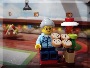 Lego Grandma holding a tray of biscuits