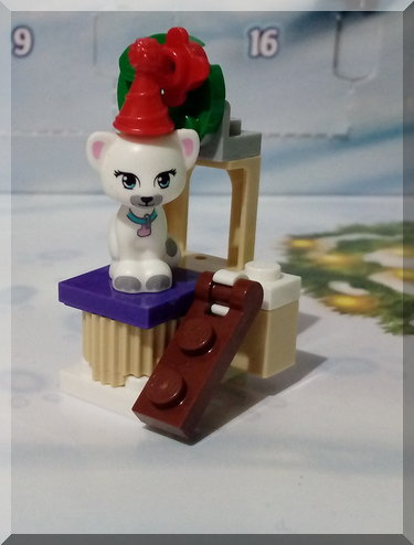 Lego cat on a scratching post stand