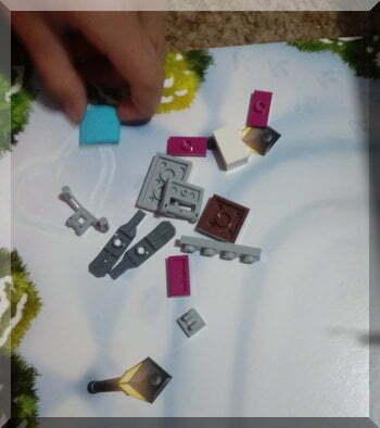 Pile of Lego pieces to create a ski mobile