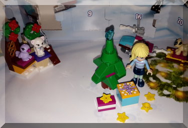 Christmas presents underneath a Lego Christmas tree