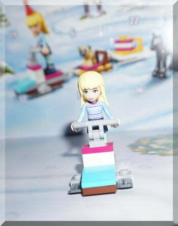 Lego girl on a ski-mobile