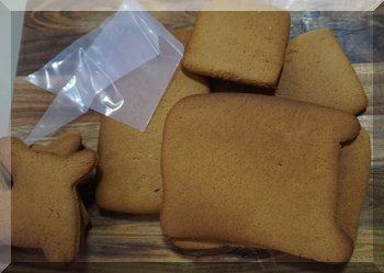 gingerbread pieces and an empty piping bag