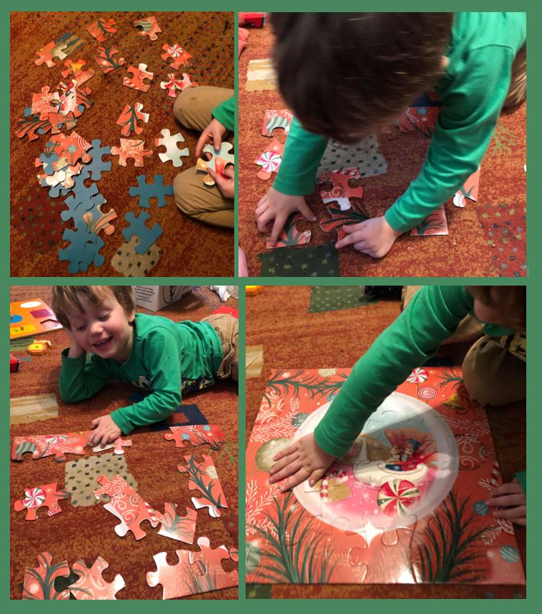 Young boy putting together the Nutcracker puzzle