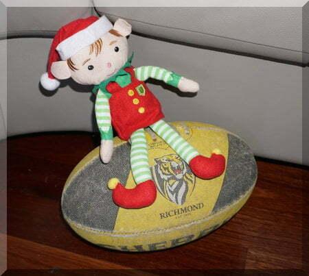 Christmas elf sitting on a Richmond footy