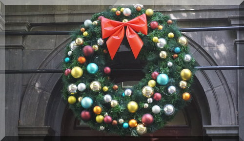 large green wreath decorated with coloured baubles