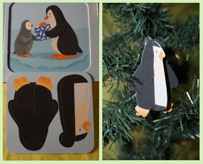 Cardboard penguin hanging on a Christmas tree