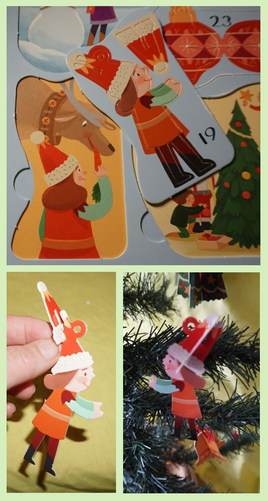 AN elf holding a baby rattle ornament