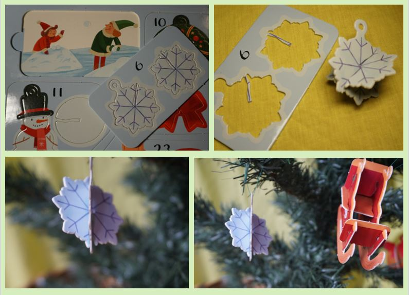 Cardboard nowflake Christmas decoration hanging on a tree and being pressed out of a book