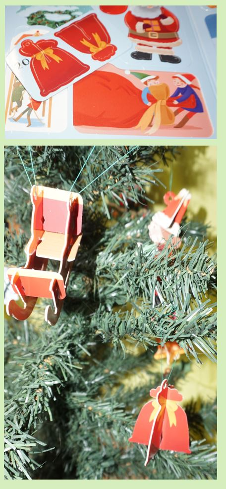 Santa's sack pressed out ornament hanging on a tree hear a sleigh