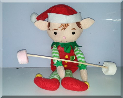Christmas elf lifting marshmallows on a stick as weights