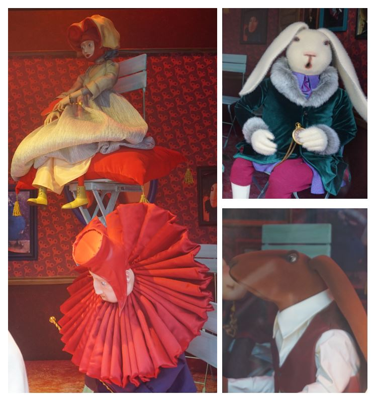 The rabbit, the queen and others in the drawing room with Alice