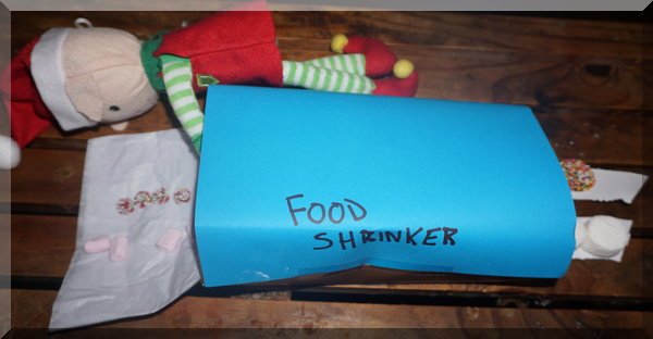 CHristmas elf's food shrinking machine with the elf and lollies