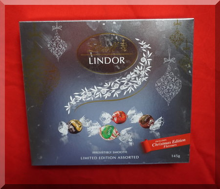 silver box containing Lindt chocolate balls