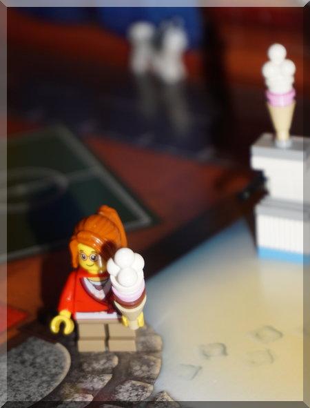 Lego girl holding an ice-cream near the ice-cream machine