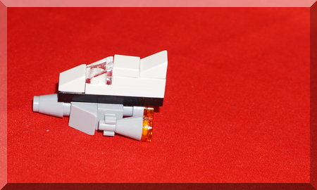 Lego spaceship on a red background