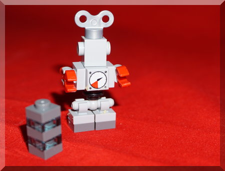 small Lego robot on red background