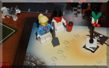 Lego work woman and snowman near lamp