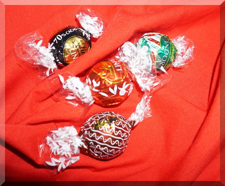 Four wrapped Ind balls from their Christmas range