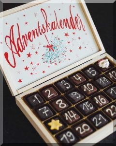wooden box with numbered chocolates