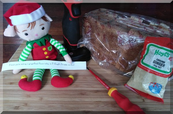 Christmas elf preparing to build a gingerbread house