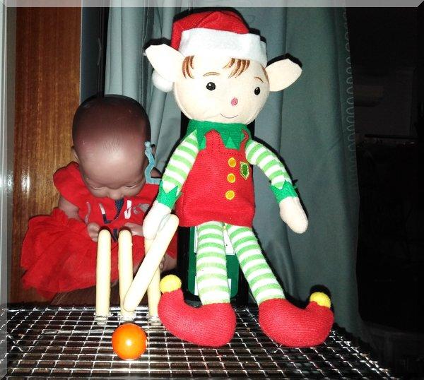 Christmas elf batting at cricket