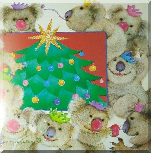 Laughing koalas around a Christmas tree