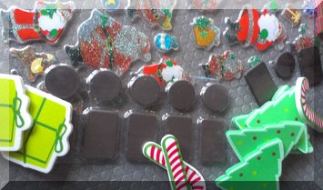 small black magents with varius Christmas themed stickers