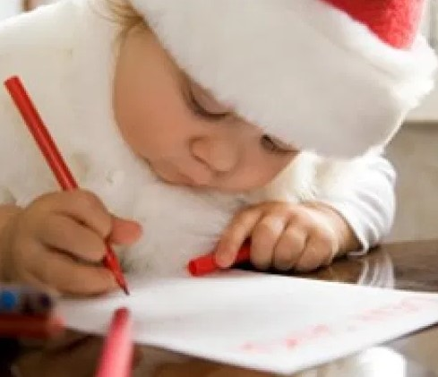Santa sitting and reading a letter
