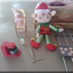 Christmas elves cooking biscuits
