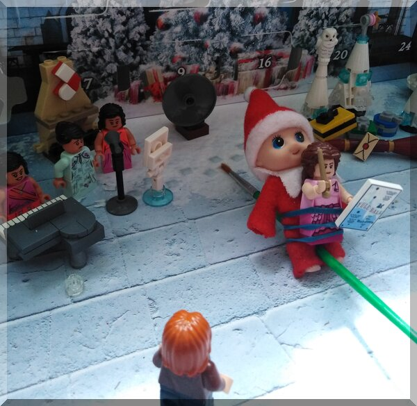 Christmas elf visiting Hogwarts advent calendar with Hermione on a paintbrush