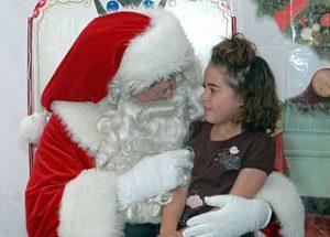 girl sitting in Santa's lap[