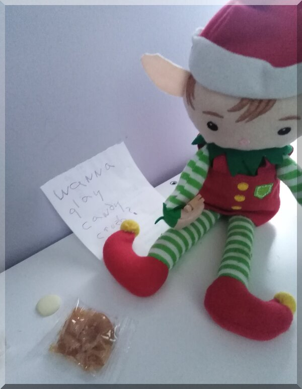 Christmas elf playing candy crush with real lollies and a hammer!