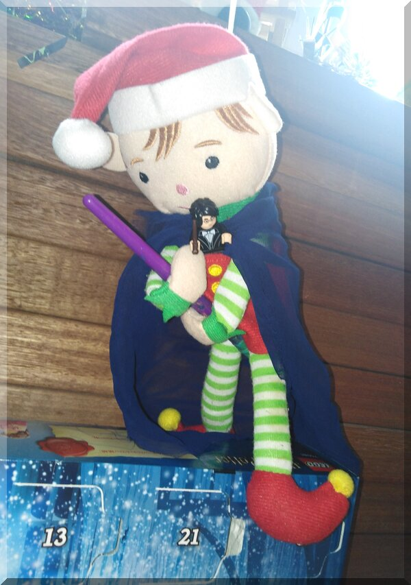 Christmas elf visiting Hogwarts advent calendar with Harry on a paintbrush